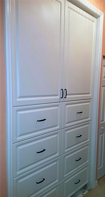 In-wall pantry or linen closet by Reliable Cabinet Designs